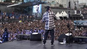 Russia - Moscow, 10.02.2019: russian hip hop and rap live music concert with a frontman and cheering fans. Action. Rear stock video