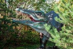 Russia, Moscow - September 29, 2018: Dinosaur baryonix. Huge full-size head. On a background of forest royalty free stock photo