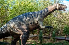 Russia, Moscow - September 29, 2018: A huge dinosaur on the background of forest. Russia, Moscow - September 29, 2018: A huge dinosaur on the background of the royalty free stock images