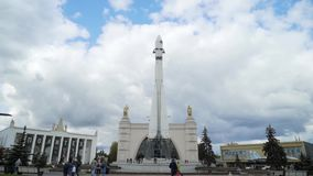 Russia, Moscow-September, 2019: Monument of white rocket on background of walking tourists. Action. Bottom view of large stock video