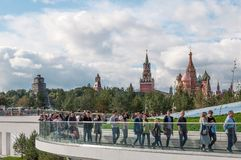 RUSSIA, MOSCOW - SEPTEMBER 16, 2017: Moscow Kremlin and St. Basil`s Cathedral view and new Poryachiy bridge in the new. Zaryadye Park in Moscow, Russia Stock Photos