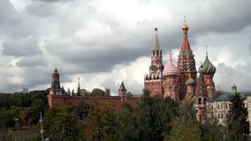 Russia, Moscow-September, 2019: Red square with St. Basil`s Cathedral on background of cloudy sky. Action. Beautiful and stock video footage