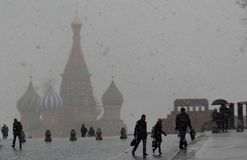 Russia. Moscow. Snow blizzard on Red Square. Snow blizzard on Red Square. The Kremlin tower with a mausoleum, people are walking along the red square stock photography