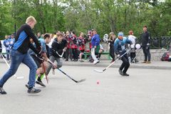 Russia, Murmansk-June 24, 2018: celebration of youth day in Russia, youth plays hockey. The team plays hockey with the ball stock photo