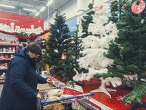Russia, Murmansk-November 10, 2018: people choose Christmas toys for Christmas tree in supermarket royalty free stock photo