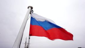 The flag of the Russian federation waving in the wind, Russian flag background. Russia national flag, Russian flag on flagpole waving background, the flag of the stock video footage