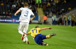 Russia national team defender Roman Neustaedter and Sweden national team midfielder Viktor Claesson. Solna, Sweden - November 20, 2018. Russia national team royalty free stock photography