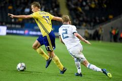 Russia national team defender Vladislav Ignatyev and Sweden national team midfielder Viktor Claesson. Solna, Sweden - November 20, 2018. Russia national team royalty free stock photo