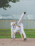 Russia Nikolskoe July 2016 competition at crossfit man shows to dance capoeira. Russia Nikolskoe July 2016 competition in crossfit, the man in white shows dance Stock Photos