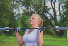 Russia Nikolskoe July 21016 competition for crossfit sporty girl pesters rod Royalty Free Stock Photography