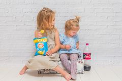 Russia, Nikolskoye, August 28, 2018-the girls children sitting o stock photography