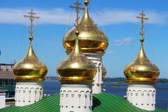 Russia, Nizhny Novgorod: Golden domes. Against the blue sky and the Volga River stock photography