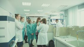 Russia Novosibirsk 2016: Chemistry lesson in high school. Russia Novosibirsk 2016: Chemical Laboratory at the University. School study chemistry. Students in stock video
