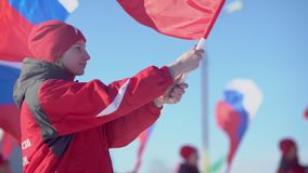 Russia, Novosibirsk, 2016: Column athlete carries the flag of Russia. Russia, Novosibirsk, 2016: Athletes in winter clothes carry the Russian flag. Column stock video