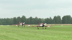 Russia, Novosibirsk, July 31, 2016: Two Yak-52 on the runway. Russia, Novosibirsk, July 31, 2016: The Yakovlev Yak-52. Two Yak-52 preparing for takeoff. Yak-52 stock video footage