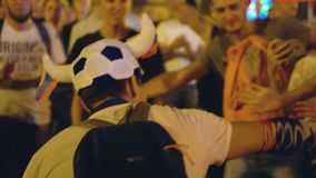 Guy in football cap gives five mobs in honor of victory of Russia on football. Russia, Novosibirsk, July 2, 2018: Victory of Russia in a football match. People stock video