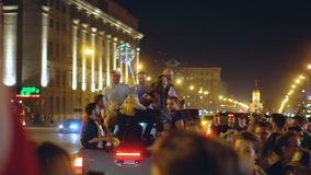 People having fun in night city on road celebrates victory of a football match. Russia, Novosibirsk, July 2, 2018: Victory of Russia in football match. People stock video