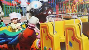 Russia, Novosibirsk, 4 june 2017. Children`s toy locomotive rolls children in the attraction park on sunny summer day in. Children`s toy locomotive rolls stock video footage