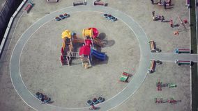 Russia, Novosibirsk. 14 march 2015. Top view of colorful new playground for kids near apartment building. stock footage