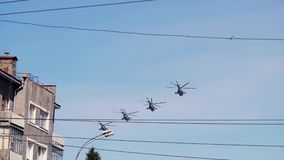 Russia, Novosibirsk, 9 may 2015. Helicopters fly in sky on air show devoted of day of the victory. 4k stock video footage