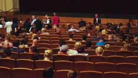 Russia, Novosibirsk, 30 may 2015. People sit on their seats before the performance in the movie theater. stock video footage