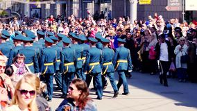 Russia, Novosibirsk, 9 may 2015. Soldiers being greeted by crowds in 9th may is day of victory. 4k. 3840x2160. Soldiers being greeted by crowds in 9th may is day stock video footage