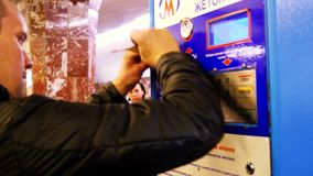 Russia, Novosibirsk, 9 may 2015. Woman buys a train ticket from vending machines at subway station. 3840x2160. Woman buys a train ticket from vending machines at stock video footage