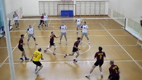 Russia, Novosibirsk. 21 october 2015. High School Volleyball game. Volleyball team playing in slowmotion. 1920x1080 stock footage
