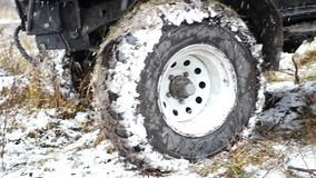 11. 10. 16, Russia, Novosibirsk, Salair Rubilovo.. Big jeep with lots of wide koleskh protektorm covered in snow and stock footage