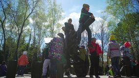 Russia, Novosibirsk, 9th May 2017: children in military equipment park stock footage