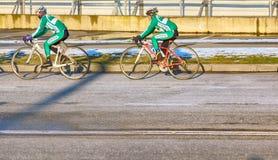 Bike training in spring on asphalt road. Russia, Olympic village - January 31, 2017: bike training in spring on asphalt road stock photography