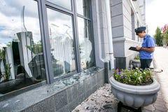 Russia, Omsk - August 4, 2015: Broken window of city hall Stock Image