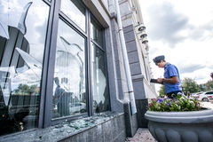Russia, Omsk - August 4, 2015: Broken window of city hall Royalty Free Stock Photo