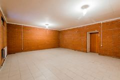 Russia, Omsk- August 02, 2019: interior room empty basement with brick walls
