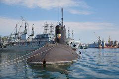 Russia, the peninsula of Crimea, the city of Sevastopol. 21 june 2018: Russian submarine. `Novorossiysk` degaussing by crew at Southern bay of Sevastopol Harbor royalty free stock image