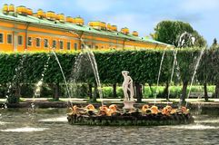 Pond with a fountain decorated by the figure of Apollo royalty free stock image