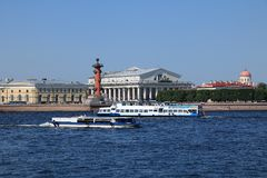 Russia, Petersburg, June 8, 2019. Spit of Vasilyevsky Island. Pictured is the Rostral Column and the Stock Exchange building on. The bank of the Neva against stock photography