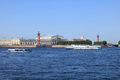 Russia, Petersburg, June 8, 2019. Spit of Vasilyevsky Island. Pictured is the Rostral Column and the Stock Exchange building on. The bank of the Neva against stock photos