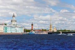 Russia. Petersburg. Vasilevsky island and Rostral columns. Russia. Petersburg. An arrow of Vasilevsky island and Rostral columns Stock Photography