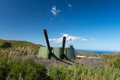 Russian artillery battery turret gun, Cannon on the Hill. Russia, Primorskiy Region, historical monument on Gamov peninsula. Russian artillery battery turret royalty free stock photos