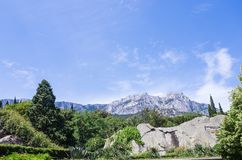 View of the Ai-Petri mountain from the Vorontsov Palace. Russia, the Republic of Crimea, the city of Alupka. 06/09/2018 Royalty Free Stock Photo