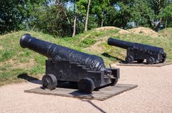 Ancient ship cannons. Russia, the Republic of Crimea, the city of Sevastopol. Antique cast-iron muzzle-loaded guns on Malakhov Hill royalty free stock photos
