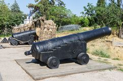 Ancient ship cannons. Russia, the Republic of Crimea, the city of Sevastopol. Antique cast-iron muzzle-loaded guns on Malakhov Hill stock photography