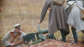 RUSSIA, REPUBLIC OF TATARSTAN 30-09-2019: A reconstruction of military operations in Russia in 1917 - Soldiers putting a. Machine gun in the right place on the stock video