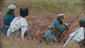 Russia, Republic of Tatarstan 30-09-2019: A reconstruction of military operations in Russia in 1917 - Several soldiers. Sitting in the trenches ready for stock video footage