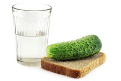 From Russia with Respect. A glass of vodka with a slightly salted cucumber on a rye-bread slice Royalty Free Stock Photos