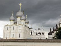 Rostov Kremlin . White church against the dark stormy sky. Russia. Rostov. June, 17, 2017. Rostov Kremlin that is located in Rostov city .The cathedral of the Stock Photos