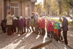 Russia Ryazan October 20, 2017: a group of children go to the library for classes stock photography