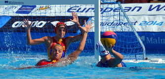 Russia's RYZHKOVA Daria (RUS, 12) throwing the ball. Budapest, Hungary - Jul 16, 2014. Russia's RYZHKOVA Daria (RUS, 12) throwing the ball. The Waterpolo Stock Images