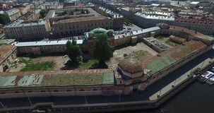 Russia, Saint-Petersburg, Aerial view panorama field of Mars, Trinity bridge, Peter and Paul fortress, roofs, Summer. Garden, shadows of trees, Neva river stock video footage